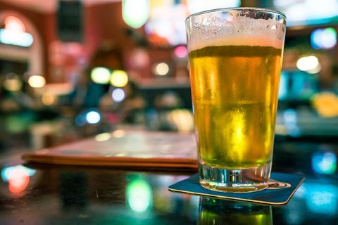 Close-Up Of Beer Glass On Table In Restaurant