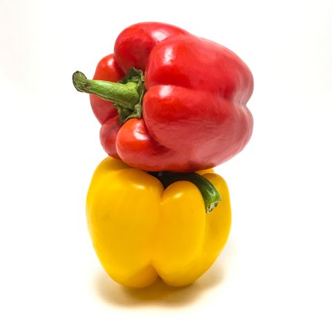 close up of bell peppers on white background