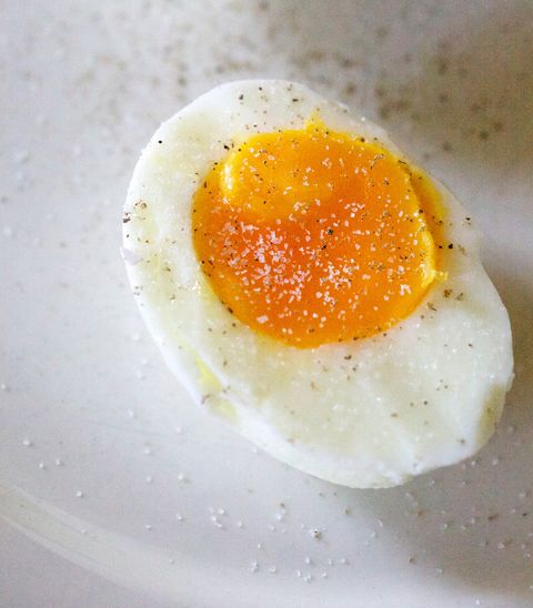 close up of boiled egg slice in plate