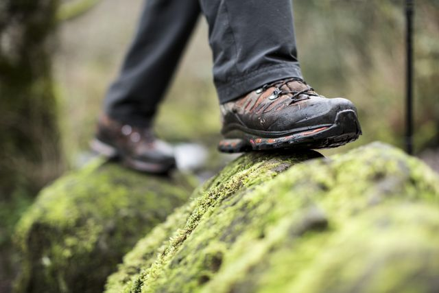 close up of boots on a mossy rock