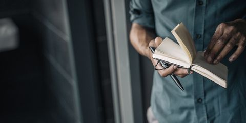 Close-up of businessman holding diary