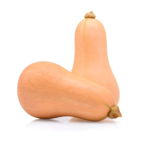 Close-Up Of Butternut Squashes Against White Background