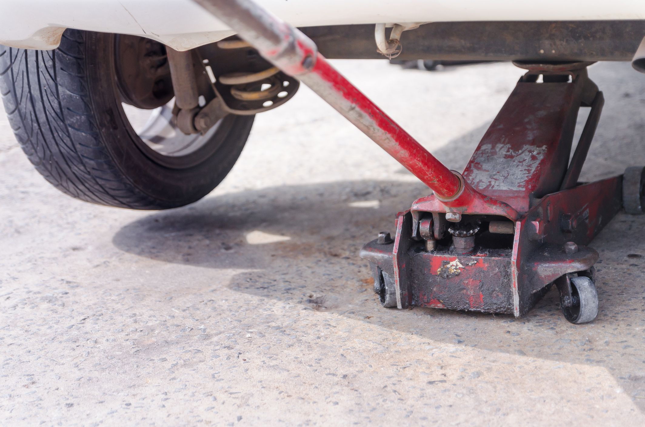 how to change a tire changing a flat tire guide 12 volt solar wiring-diagram close up of car jack on road