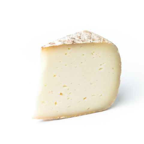 Close-Up Of Cheese Slice Against White Background