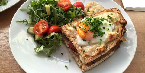 Close-Up Of Croque Madame Served In Plate On Table
