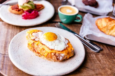 close up of croque madame with fried sunny side up egg on the table