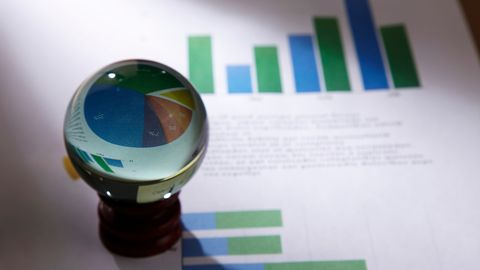 Close-Up Of Crystal Ball On Graph Papers