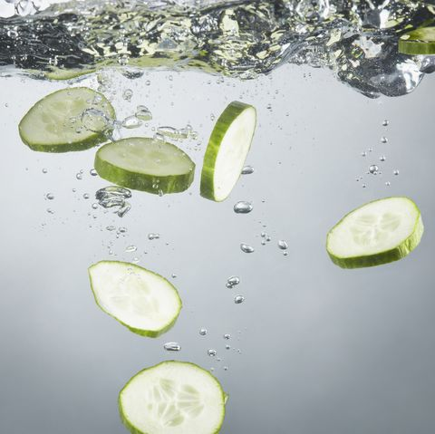 close up of cucumber slices in splashing water