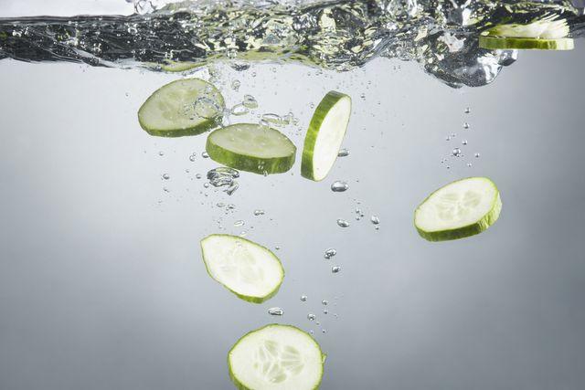 closeup of cucumber slices in splashing water