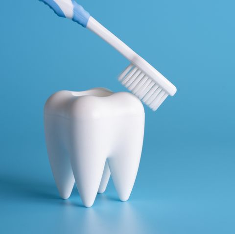 close up of dental equipment over blue background