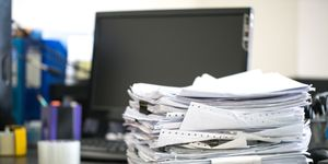 Close-Up Of Documents On Desk At Office