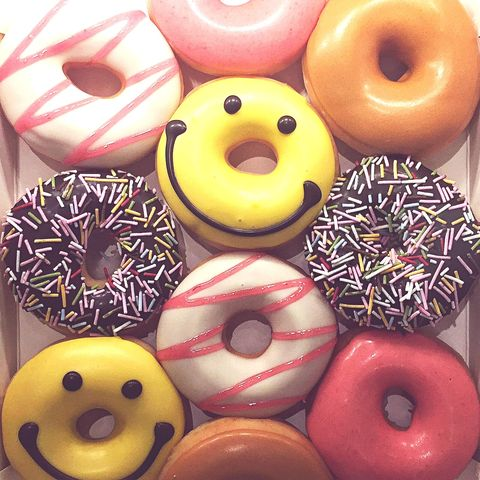 close up of donuts in container