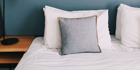 Close-Up Of Empty Bed At Home
