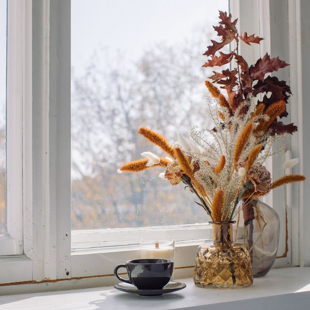 close up of flower vase on window sill