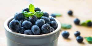Close-Up Of Fresh Blueberries In Bowl On Table