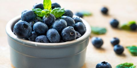 close up of fresh blueberries in bowl on table