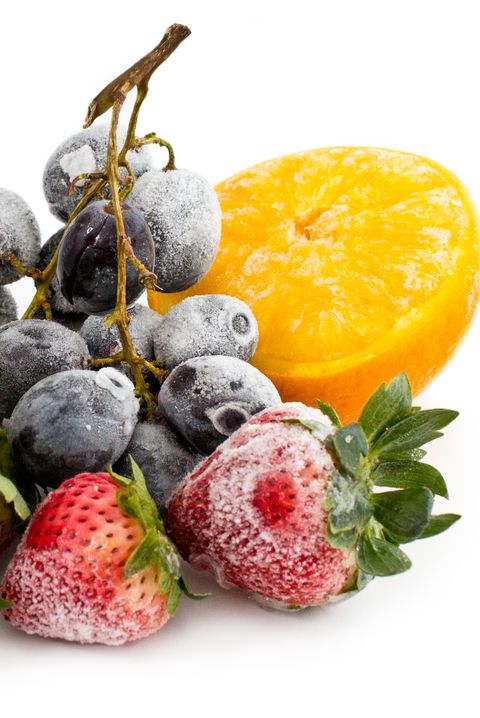 Close-Up Of Frozen Fruits Against White Background