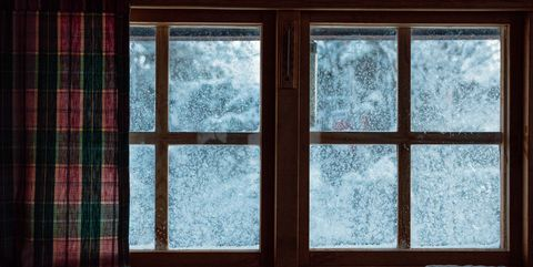Close-Up Of Frozen Window At Home