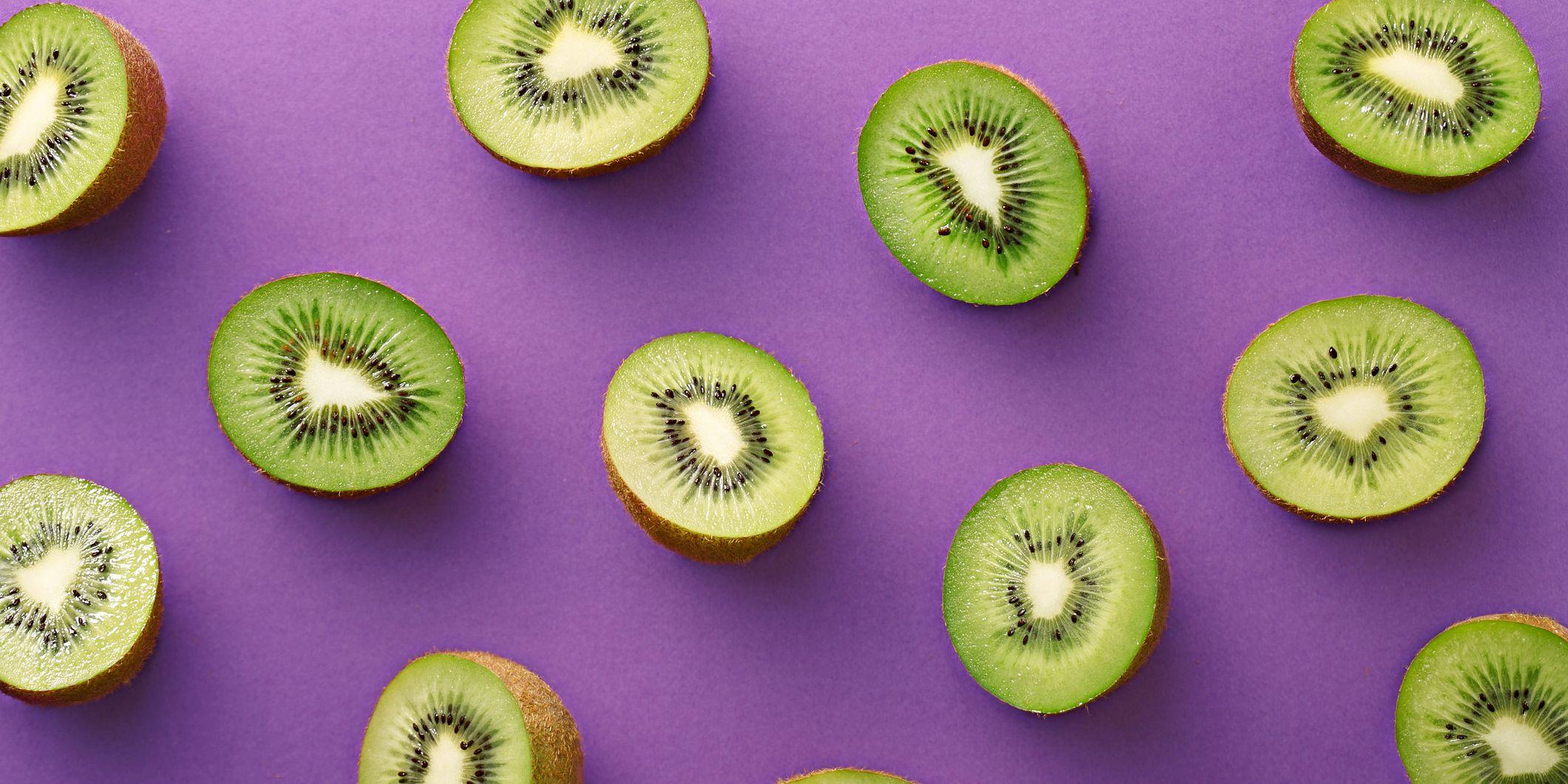 Close-Up Of Kiwi Fruits Over Purple Background
