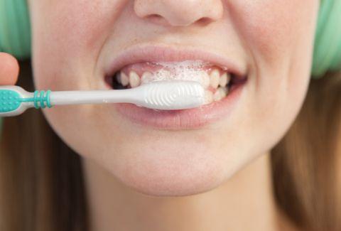 Close up of girl brushing her teeth