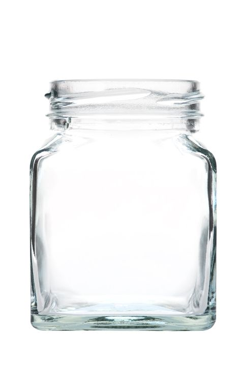 close up of glass jar against white background