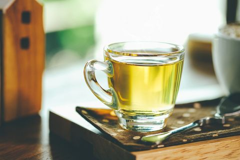 close up of green tea in cup on table