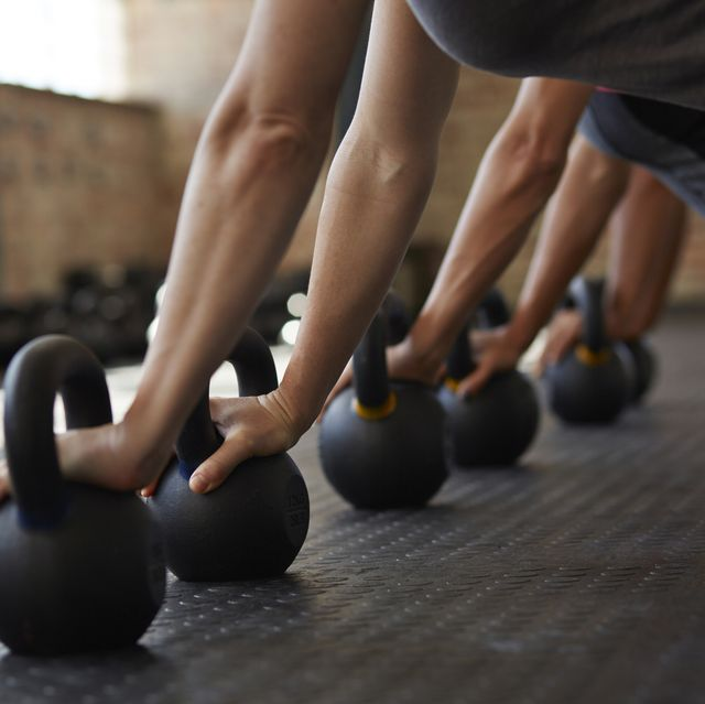 Close-up of group doing push-up's at gymclass