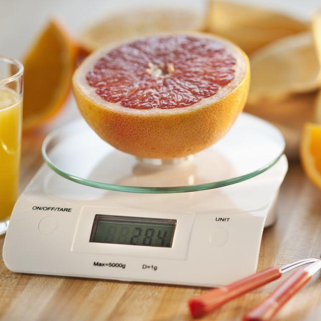 close up of half of orange on kitchen scale