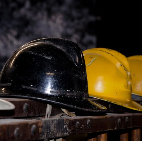 Close-Up Of Hardhats On Table