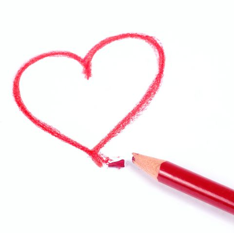 Close-Up Of Heart Shape And Broken Red Colored Pencil On White Background