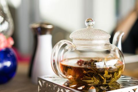 herbal tea on the table with a kettle