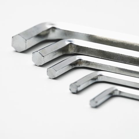 close up of hex wrench against white background