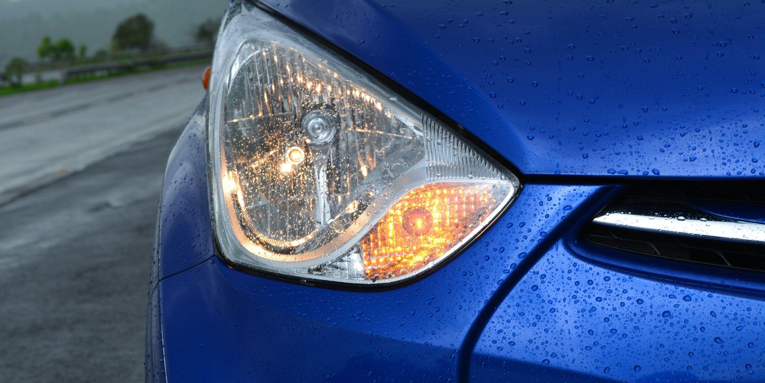 Close-Up Of Illuminated Car Headlight