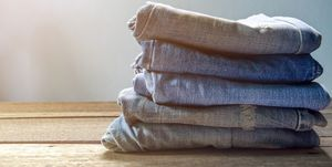Close-Up Of Jeans Stacked On Table