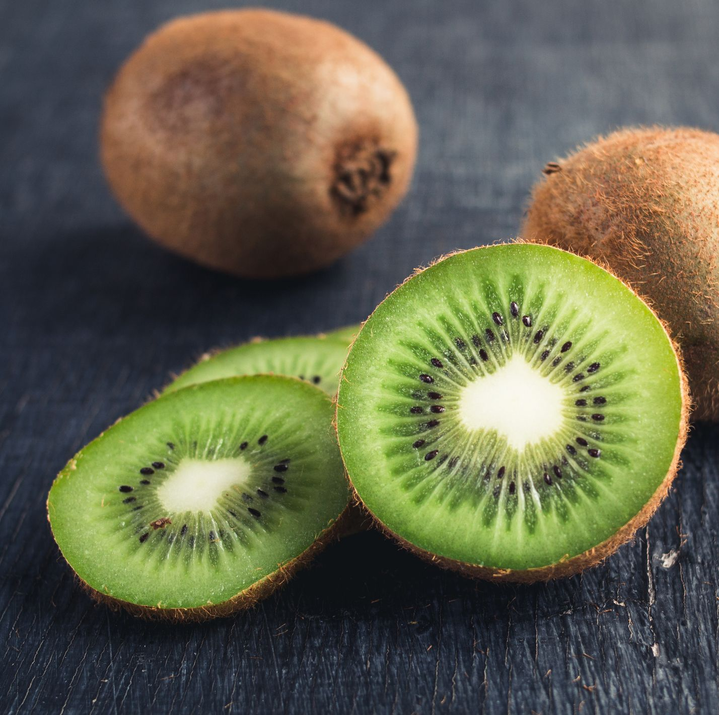 Close-Up Of Kiwi Fruits On Table