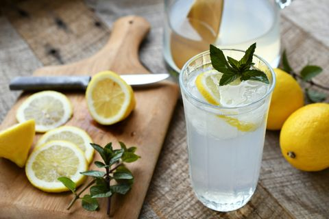 close up of lemonade on wooden table