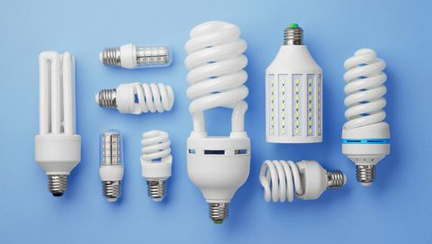 Close-Up Of Lighting Equipment On Blue Background
