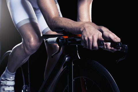 Close-up of man cycling, studio shot