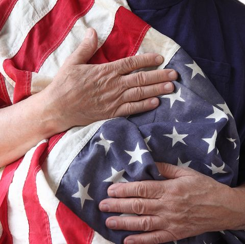 close up of man holding american flag