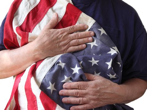 Close-Up Of Man Holding American Flag