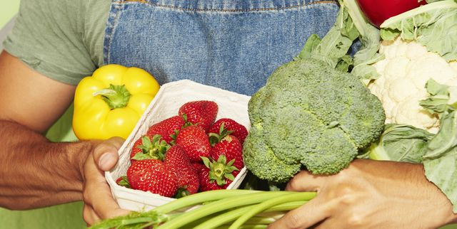 Close up of man holding fresh vegetables