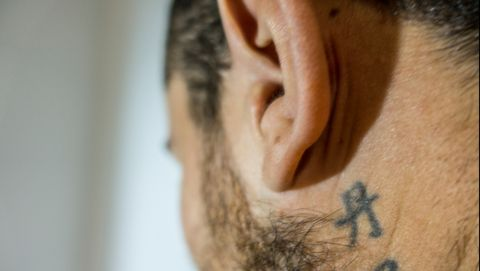 Close-Up Of Man With Tattoo Below Ear