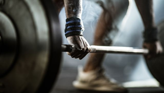 close up of man's hand during deadlift