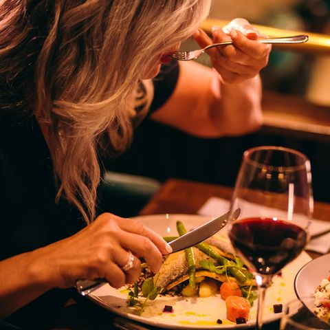 Close-up of mature woman healthy dinner at luxurious restaurant