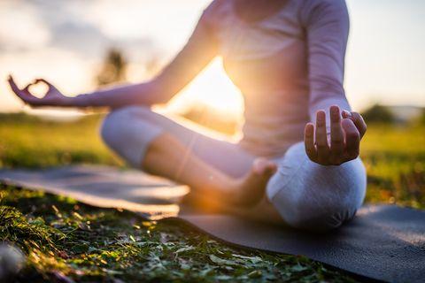 close up of meditation in park at sunrise