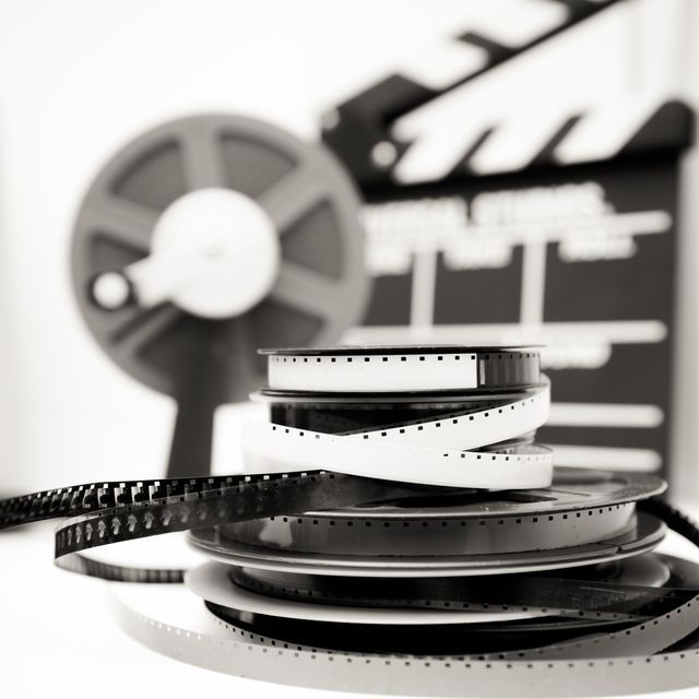Close-Up Of Old-Fashioned Film Reels On Table