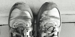 Close-Up Of Old Sports Shoe On Floor