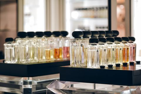 close up of parfum bottles on table