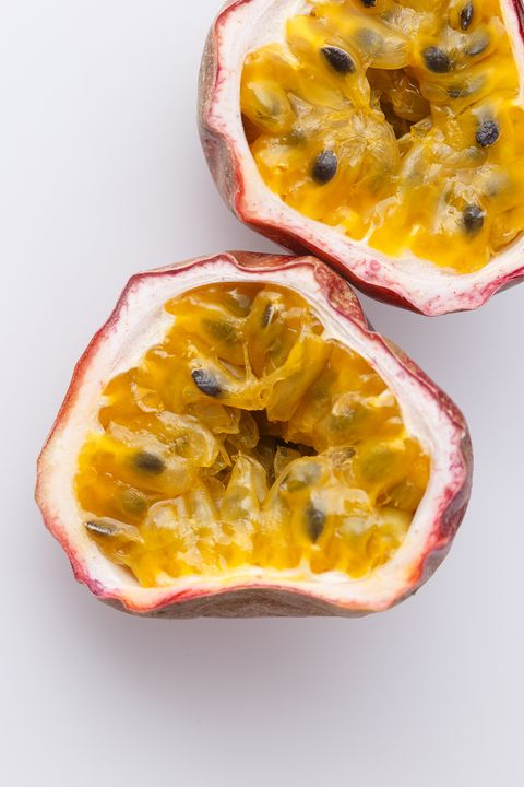 Close-Up Of Passion Fruit Slices On White Background