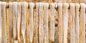 Close-Up Of Pasta Hanging Against Wall